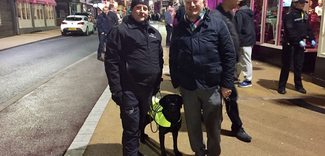 Dog handler Simon and drug dog 'Moss' with Leicestershire Police & Crime Commissioner, Lord Willy Bach